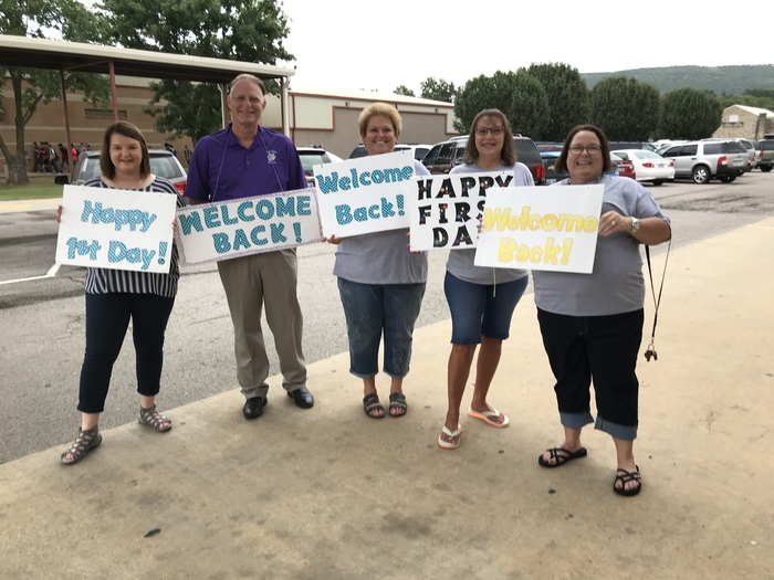 Teachers greeting students on their first day of school.